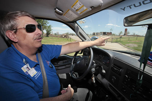 Moore Emergency Management Director Gayland Kitch talks about tornadoes that have struck his city.  <strong>David McDaniel - The Oklahoman</strong>