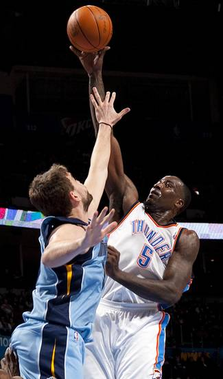 Oklahoma City's Kendrick Perkins (5) shoots the ball in front of Memphis' Marc Gasol (33) during the NBA game between the Oklahoma City Thunder and the Memphis Grizzlies at Chesapeake Energy Arena in Oklahoma CIty, Friday, Feb. 3, 2012. Photo by Bryan Terry, The Oklahoman
