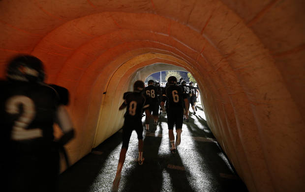 Norman players run on to the field before the high school football game between Norman and Yukon at Norman High School in Norman, Okla., Thursday, Nov. 8, 2012. Photo by Sarah Phipps, The Oklahoman