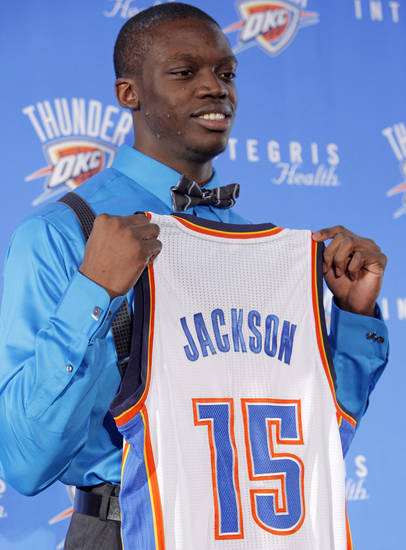 Oklahoma City Thunder draft pick Reggie Jackson holds his jersey during a news conference at the Boys and Girls Club of Oklahoma County in Oklahoma City, Saturday, June 25, 2011. The Thunder selected Reggie Jackson with the 24th pick in this year's NBA draft. Photo by Nate Billings, The Oklahoman