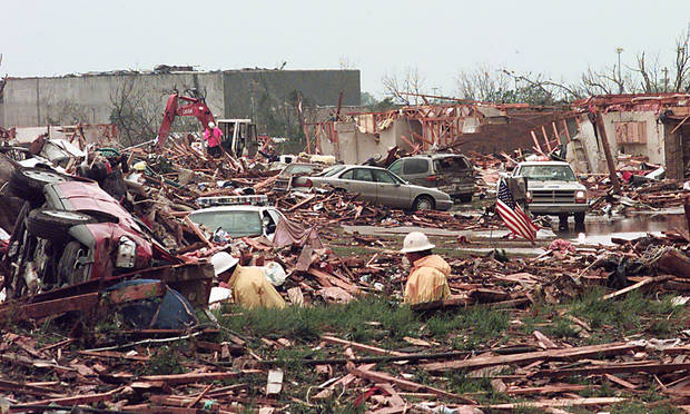 MAY 3, 1999 TORNADO: TORNADO DAMAGE: WORKERS LOOK THREW THE DEBRIS OF A FLATTENED APARTMENT COMPLEX AT 122 AND WESTERN AFTER A TORNADO WENT THREW THE TOWN OF MOORE, OK. WESTMOORE HIGH SCHOOL IS IN THE BACKGROUND OFF OF WESTERN AND 12TH STREET.