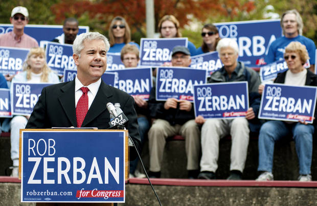 This photo taken Oct. 3, 2012 shows Wisconsin Congressional candidate Rob Zerban speaking at campaign event inJanesvilles, Wis. As Zerban spent his morning on his hands and knees scrubbing a toilet in a homeless shelter. Half a country away, Paul Ryan stood under a spotlight in Virginia talking about why he should be the next vice president. So it goes in Zerban�s longshot bid to seize the House seat Ryan has held for 14 years. While the Republican vice presidential hopeful has jetted around the country touting Mitt Romney, the Kenosha Democrat has been getting his hands dirty in southern Wisconsin�s 1st Congressional District. (AP Photo/Mark Kauzlarich, The Janesville Gazette)