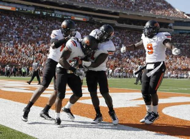 OSU celebrates Oklahoma State's Jeremy Smith (31) touchdown during first half of a college football game between the Oklahoma State University Cowboys (OSU) and the University of Texas Longhorns (UT) at Darrell K Royal- Texas Memorial Stadium in Austin, Texas, Saturday, Oct. 15, 2011. Photo by Sarah Phipps, The Oklahoman