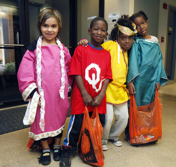Positive Tomorrows kids Ayana, left, Tony, LeRuby, and Myia trick or treat through the offices of the Oklahoma Medical Research Foundation. By Paul Hellstern, The Oklahoman <strong>PAUL HELLSTERN - Oklahoman</strong>