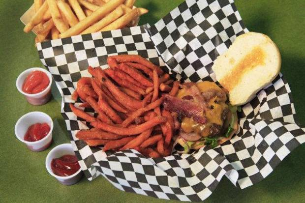 Sweet potato fries and a bacon slider at Home Run Sliders. <strong>David McDaniel - The Oklahoman</strong>