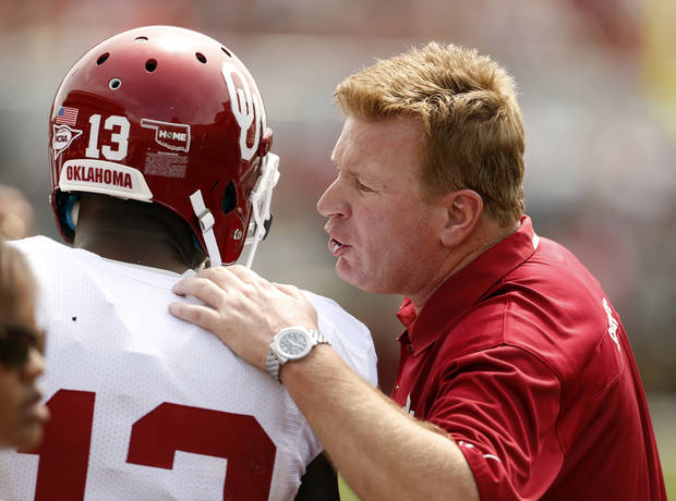 Defensive coordinator Mike Stoops talks with Ahmad Thomas during the Spring College Football Game of the University of Oklahoma Sooners (OU) at Gaylord Family-Oklahoma Memorial Stadium in Norman, Okla., on Saturday, April 12, 2014.  Photo by Steve Sisney, The Oklahoman