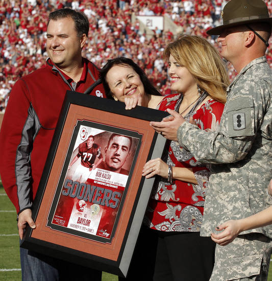 Former Sooner player and Vietnam war casualty Bob Kalsu is honotred during the college football game between the University of Oklahoma Sooners (OU) and the Baylor University Bears (BU) at Gaylord Family-Oklahoma Memorial Stadium in Norman, Okla., Saturday, Nov. 10, 2012.  His son Bob, wife Jan and daughter Jill Horning and Staff Sgt Robie Stricklin are presented with a plaque during a time out in the first half.  Photo by Steve Sisney, The Oklahoman