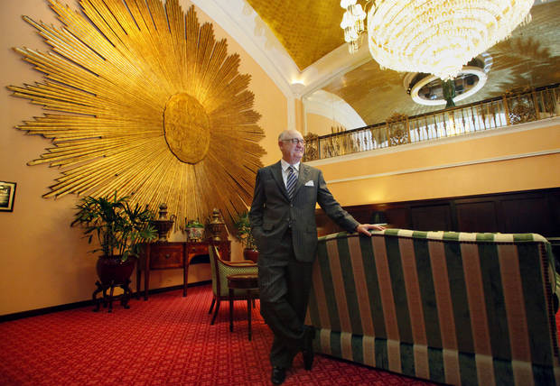 Amway Grand Plaza Hotel CEO Joe Tomaselli stands outside the lobby of the hotel on Oct. 17, 2012 in Grand Rapids, Mich. For the past 25 years, Tomaselli has stayed in a room at the Amway Grand Plaza Hotel while Patty, his wife of 42 years, continued to live at their home in suburban St. Louis. Tomaselli, said he commutes to his hometown several times a month and intends to return there when he retires after Dec. 31.  (AP Photo/The Grand Rapids Press, Emily Zoladz) ALL LOCAL TV OUT; LOCAL TV INTERNET OUT