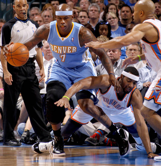 Denver's Al Harrington (7) gains control of the ball beside Oklahoma City's Lazar Hayward (11) during the NBA basketball game between the Oklahoma City Thunder and the Denver Nuggets at Chesapeake Energy Arena in Oklahoma City, Wednesday, April 25, 2012. Photo by Bryan Terry, The Oklahoman