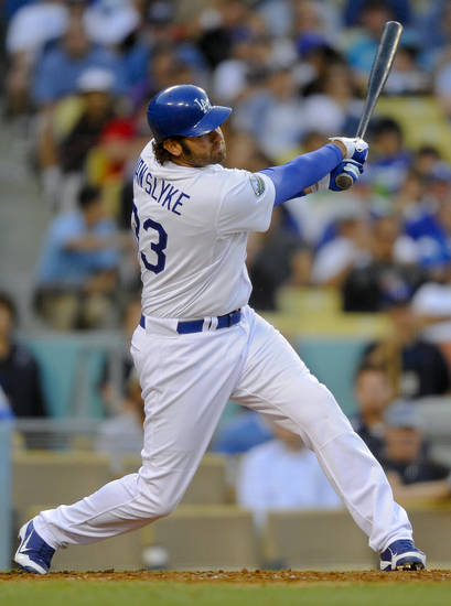 CORRECTS TO A THREE-RUN HOME RUN, NOT TWO-RUN - Los Angeles Dodgers' Scott Van Slyke hits a three-run home run to left field in the seventh inning of a baseball game against the St. Louis Cardinals, Sunday, May 20, 2012, in Los Angeles. (AP Photo/Gus Ruelas)