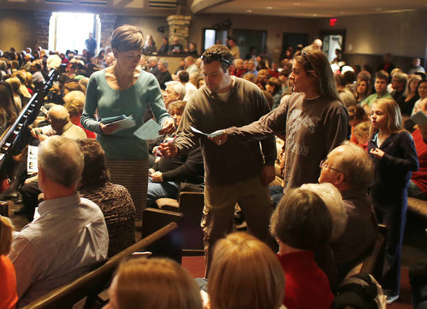 Carol Waters collects ballots after a congregational vote Sunday at First Presbyterian Church of Edmond, 1001 S Rankin in Edmond.  <strong>DOUG HOKE - THE OKLAHOMAN</strong>