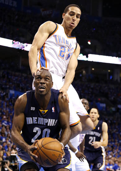 Oklahoma City's Kevin Martin (23) fouls Memphis' Quincy Pondexter (20) during Game 1 in the second round of the NBA playoffs between the Oklahoma City Thunder and the Memphis Grizzlies at Chesapeake Energy Arena in Oklahoma City, Sunday, May 5, 2013. Photo by Sarah Phipps, The Oklahoman