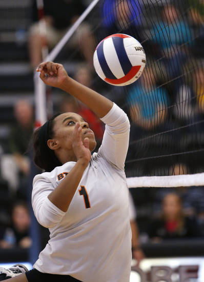 Booker T. Washington's Meriden Lee returns a ball against Shawnee during the Class 5A State Championship volleyball tournament on Friday, Oct. 12, 2012, in Moore, Okla.  Photo by Steve Sisney, The Oklahoman