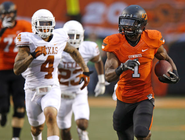 Oklahoma State&#039;s Joseph Randle (1) runs for a touchdown during a college football game between Oklahoma State University (OSU) and the University of Texas (UT) at Boone Pickens Stadium in Stillwater, Okla., Saturday, Sept. 29, 2012. Photo by Bryan Terry, The Oklahoman