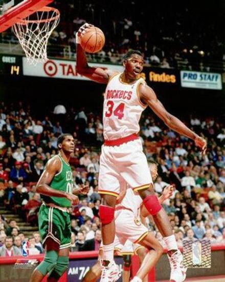Center Hakeem Olajuwon led the Houston Rockets to two world titles.
