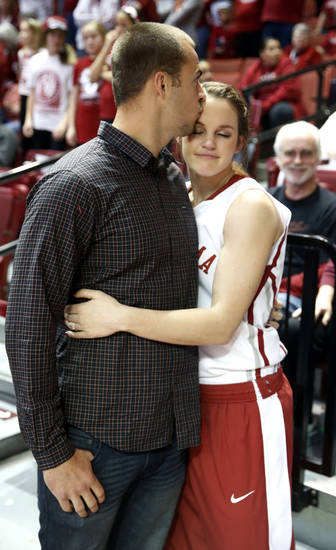 Senior Whitney Hand gets a kiss from husband Landry Jones at the Senior Day ceremony after the University of Oklahoma Sooners (OU) defeated the Kansas Jayhawks 85-77 in NCAA, women's college basketball at The Lloyd Noble Center on Saturday, March 2, 2013  in Norman, Okla. Photo by Steve Sisney, The Oklahoman