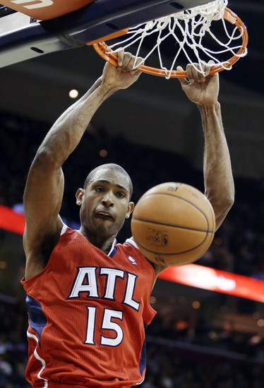 Atlanta Hawks' Al Horford dunks against the Cleveland Cavaliers in the first quarter of an NBA basketball game, Friday, Dec. 28, 2012, in Cleveland. (AP Photo/Mark Duncan)