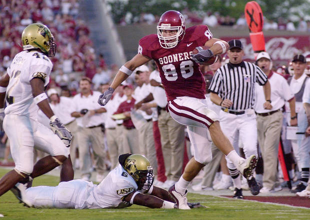 Former OU tight end Trent Smith runs past South Florida's Allynson Sheffield in a 2002 game. OKLAHOMAN ARCHIVE PHOTO