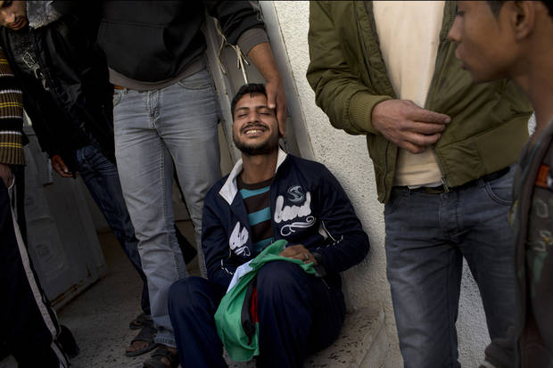 Palestinian Khaled Tafesh cries outside the morgue of Shifa Hospital before taking the dead body of his 10-month-old infant in Gaza City, Friday, Nov. 16, 2012. According to hospital reports, Haneen Tafesh died from wounds of an earlier Israeli strike. (AP Photo/Hatem Moussa)