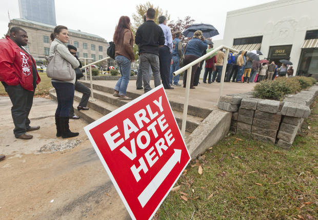 Arkansas voters line up in the rain at an early voting poling place in Little Rock, Ark., Monday, Nov. 5, 2012, the last day to vote in advance in the Nov. 6, general election. (AP Photo/Danny Johnston)