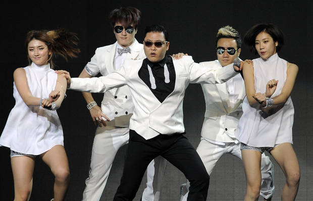 South Korean singer Psy, center, with backup dancers. <strong>Chris Pizzello - Invision/AP</strong>
