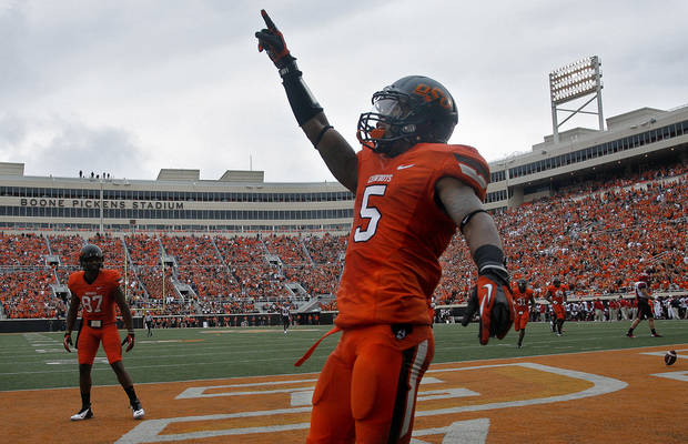 Oklahoma State's Josh Stewart (5) celebrates a touchdown during a college football game between Oklahoma State University (OSU) and the University of Louisiana-Lafayette (ULL) at Boone Pickens Stadium in Stillwater, Okla., Saturday, Sept. 15, 2012. Photo by Sarah Phipps, The Oklahoman