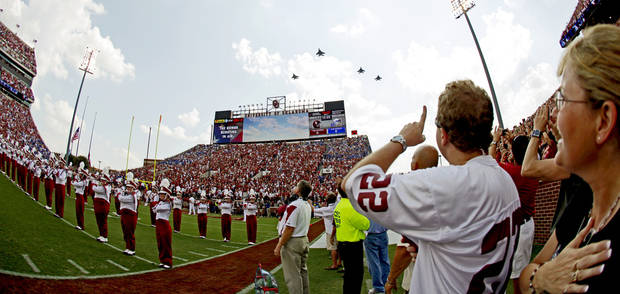 Fans watch as jets fly over the stadium before the first half of the college football game between the University of Oklahoma Sooners (OU) and Air Force (AF) at the Gaylord Family-Oklahoma Memorial Stadium on Saturday, Sept. 18, 2010, in Norman, Okla.   Photo by Bryan Terry, The Oklahoman