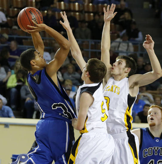Coyle's Fidel Simpson puts up a shot over Arnett's Ryne Friesen, center, and Trevor Bryant during the Class B boys state championship game between Coyle and Arnett in the State Fair Arena at State Fair Park in Oklahoma City, Saturday, March 2, 2013. Photo by Bryan Terry, The Oklahoman
