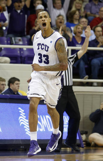 TCU forward Garlon Green (33) celebrates a 3-point shot during the first half of an NCAA college basketball game against Kansas on Wednesday, Feb. 6, 2013, in Fort Worth, Texas. (AP Photo/Sharon Ellman)