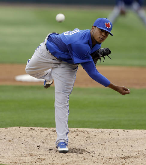 Toronto Blue Jays pitcher Jeremy Jeffress throws during the first inning of an exhibition spring training baseball game against the Baltimore Orioles, Wednesday, March 20, 2013 in Sarasota, Fla. (AP Photo/Carlos Osorio)