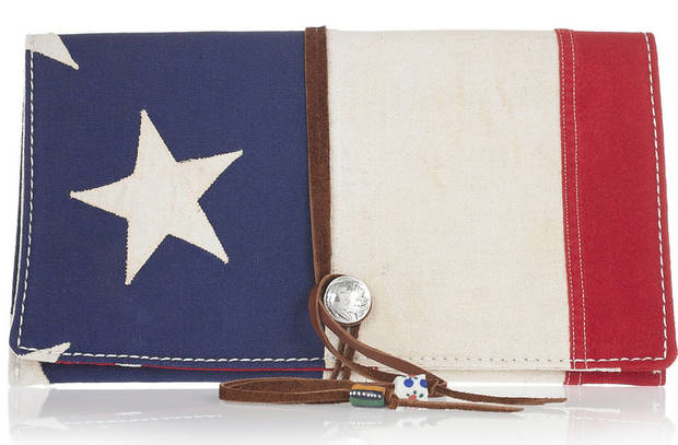 A few chic ways to accessorize this Fourth of July include this Totem Salvaged Appliqued cotton clutch $275. (Courtesy Net-a-porter.com via Los Angeles/MCT)