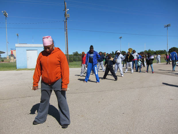 Class of 1989 graduate Mariechia Hamilton Palmer, 42, practices with the Millwood High School marching band on Saturday (Oct. 5) at the school, 6724 N Martin Luther King Avenue. Palmer was a drum major. <strong>Carla Hinton - The Oklahoman</strong>