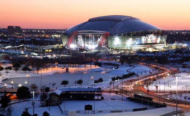 The sun sets as a view of Cowboys Stadium is shown, Friday, Feb. 4, 2011, in Arlington, Texas. (AP Photo/Tony Gutierrez) 