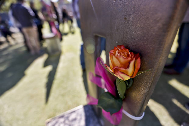A rose adorns a bombing victim's chair during the 18th Anniversary Remembrance Ceremony of the Oklahoma City bombing on Friday, April 19, 2013, in Oklahoma City, Okla.   Photo by Chris Landsberger, The Oklahoman