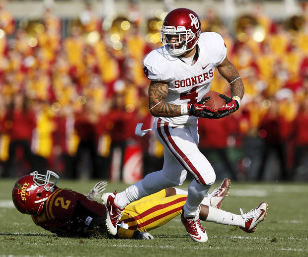 Oklahoma's Kenny Stills (4) leaves behind Iowa State's Jansen Watson (2) after a catch in the first quarter during a college football game between the University of Oklahoma (OU) and Iowa State University (ISU) at Jack Trice Stadium in Ames, Iowa, Saturday, Nov. 3, 2012. Photo by Nate Billings, The Oklahoman