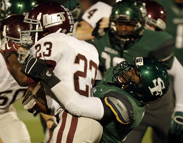 Santa Fe's Quantrell Young (12) takes down Memorial's Waylan Anderson (23) during a high school football game between Edmond Memorial and Edmond Santa Fe at Wantland Stadium in Edmond, Okla., Friday, Oct. 26, 2012.  Photo by Garett Fisbeck, The Oklahoman
