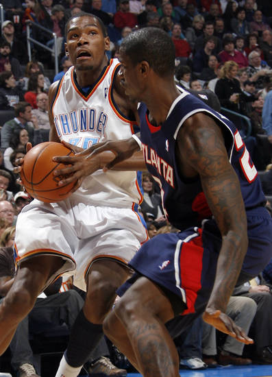 Kevin Durant (35) of Oklahoma City drives around Marvin Williams (24) of Atlanta during the NBA basketball game between the Atlanta Hawks and the Oklahoma City Thunder at the Ford Center in Oklahoma City, Tuesday, February 2, 2010. Photo by Nate Billings, The Oklahoman