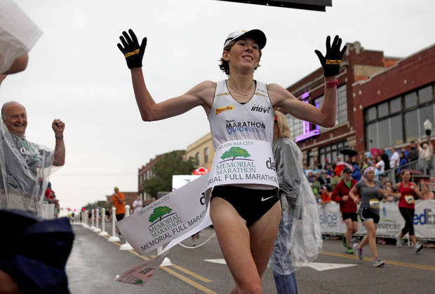 Female winner Camille Herron crosses the finish line during the Oklahoma City Memorial Marathon in Oklahoma City, Sunday, April 29, 2012. Photo by Bryan Terry, The Oklahoman