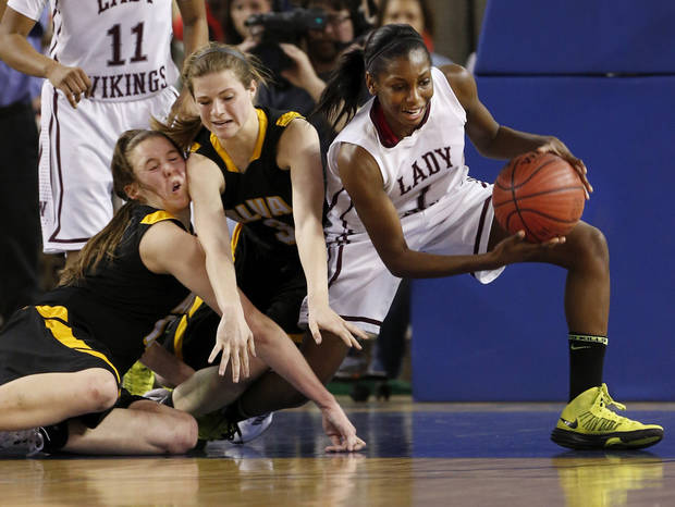 Northeast&#039;s Lanesia Williams wins the battle under the basket with Jayna Hadwiger, left, and Bailey Forell during the 2A girls championship game where the Northeast Academy Lady Vikings defeated the Alva high school Lady Bugs 53-36 at the State Fair Arena on Saturday, March 9, 2013 in Oklahoma City, Okla.  Photo by Steve Sisney, The Oklahoman
