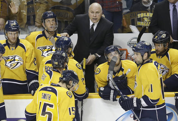 Nashville Predators head coach Barry Trotz talks to his team during a stop in play against the Dallas Stars in the second period of an NHL hockey game on Monday, Feb. 25, 2013, in Nashville, Tenn. (AP Photo/Mark Humphrey)