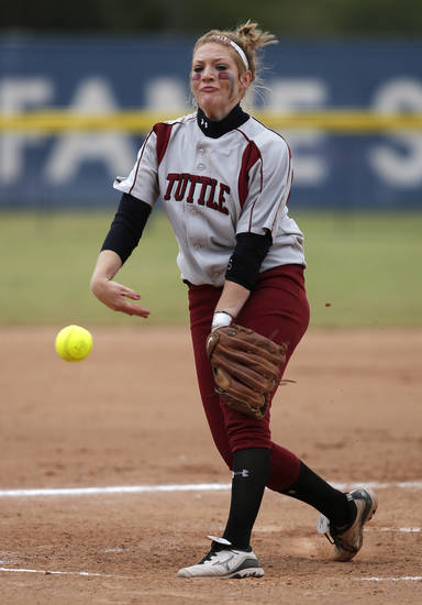 Tuttle's Shea Coats (11) pitches during the 4A state softball semifinals game between Oolagah-Talala and Tuttle at ASA Hall of Fame Stadium in Oklahoma City, Okla., Friday, Oct. 12, 2012.  Photo by Garett Fisbeck, The Oklahoman