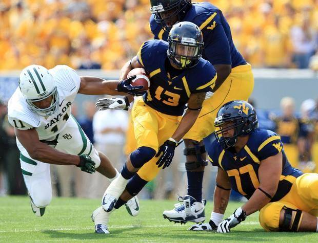 West Virginia's Andrew Buie scores a touchdown in the Mountaineers' wild 70-63 victory over Baylor in September 2012. (AP Photo)