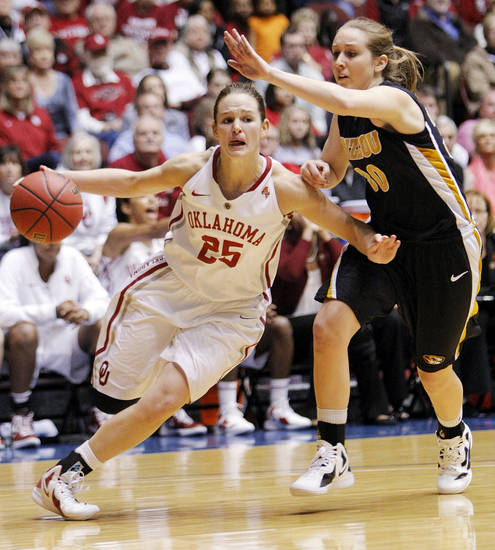 OU's Whitney Hand (25) dribbles past Missouri's Morgan Eye (30) during the Big 12 tournament women's college basketball game between the University of Oklahoma Sooners and the University of Missouri Tigers at Municipal Auditorium in Kansas City, Mo., Thursday, March 8, 2012. OU won, 70-59. Photo by Nate Billings, The Oklahoman