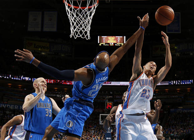Oklahoma City's Kevin Martin (23) goes for the rebound beside Dallas' Vince Carter (25) during an NBA basketball game between the Oklahoma City Thunder and the Dallas Mavericks at Chesapeake Energy Arena in Oklahoma City, Thursday, Dec. 27, 2012.  Photo by Bryan Terry, The Oklahoman