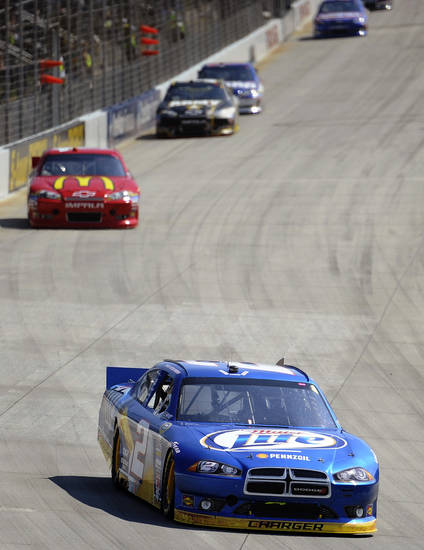 Brad Keselowski, front, competes during a NASCAR Sprint Cup Series auto race, Sunday, Sept. 30, 2012, at Dover International Speedway in Dover, Del. Keselowski won the race. (AP Photo/Nick Wass)