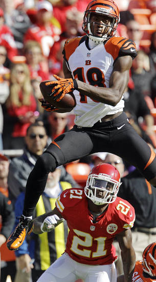 Cincinnati Bengals wide receiver A.J. Green catches a pass in front of Kansas City Chiefs cornerback Javier Arenas (21) during the first half of an NFL football game, Sunday, Nov. 18, 2012, in Kansas City, Mo. (AP Photo/Chris Ochsner)