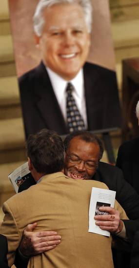 FORMER OU COLLEGE FOOTBALL PLAYER / PLANE CRASH DEATH: Dewey Selmon hugs a mourner during the funeral services  for former University of Oklahoma football player Steve Davis at the First Baptist Church on Monday, March 25, 2013, in Tulsa, Okla. Davis died in a plane crash last week in Indiana. Photo by Chris Landsberger, The Oklahoman