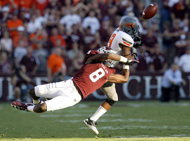 Oklahoma State 's Brodrick Brown (19) deflects a pass that was intercepted by the Cowboys' James Thomas (22) sealing OSU's win on Saturday in College Station, Texas. Photo by Sarah Phipps, The Oklahoman