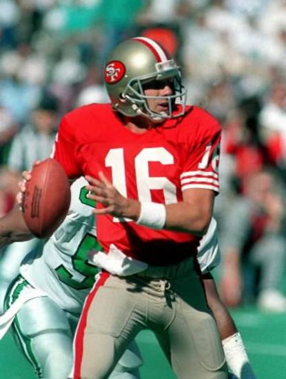 San Francisco 49ers quarterback Joe Montana looks for a receiver during a football game against the Philadelphia Eagles in Philadelphia, in this September 24, 1989 photo. Montana will be inducted into the Pro Football Hall of Fame in Canton, Ohio Saturday July 29, 2000. (AP Photo/Rusty Kennedy)