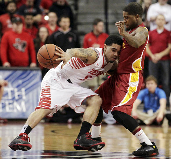Texas Tech's Josh Gray, left, tries to get around Iowa State's Korie Lucious during their NCAA college basketball game, Wednesday, Jan. 23, 2013, in Lubbock, Texas. (AP Photo/The Avalanche-Journal, Stephen Spillman) ALL LOCAL TV OUT